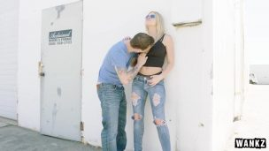 Blonde Girl Leaning Against The Wall and Making Love